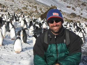 With Adelie penguins in Antarctica