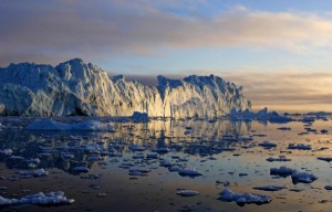 The midnight sun illumines icebergs in Greenland