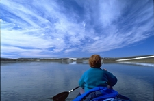 Paddling the Thomsen River. Photo: Wayne Lynch, Parks Canada.