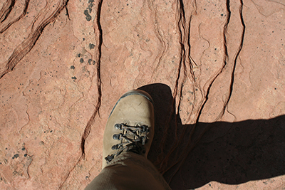Hiking boots on red rock