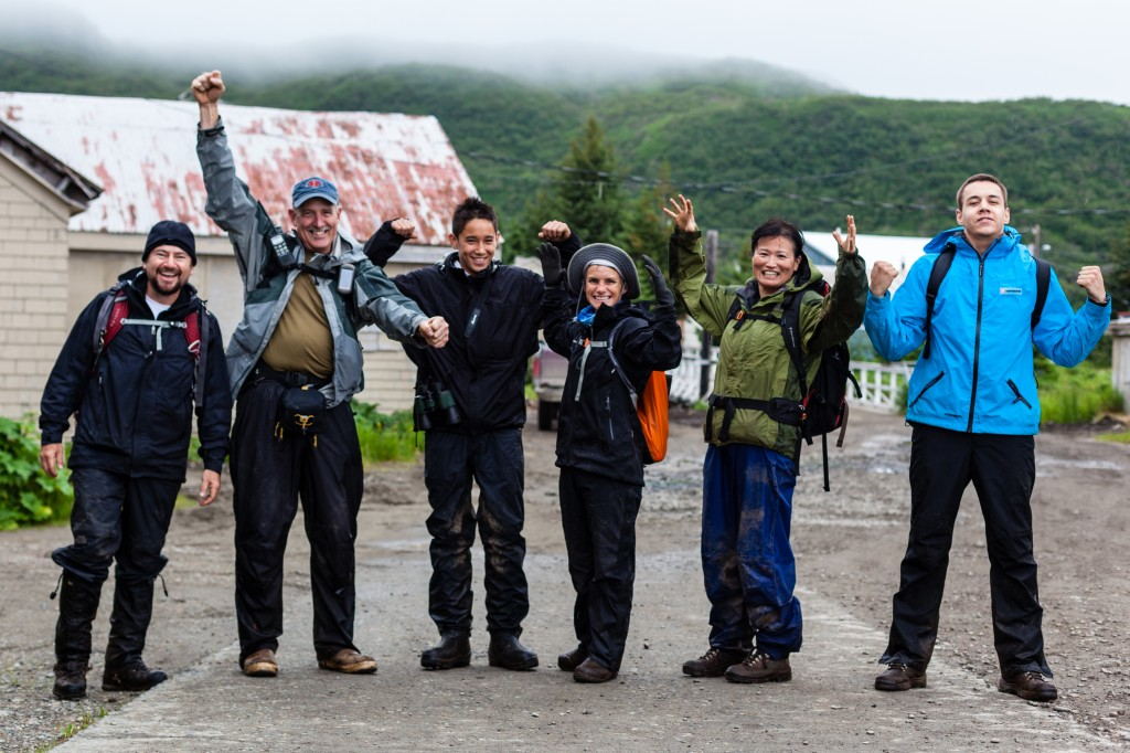 Teen and adult travelers celebrating in Alaska