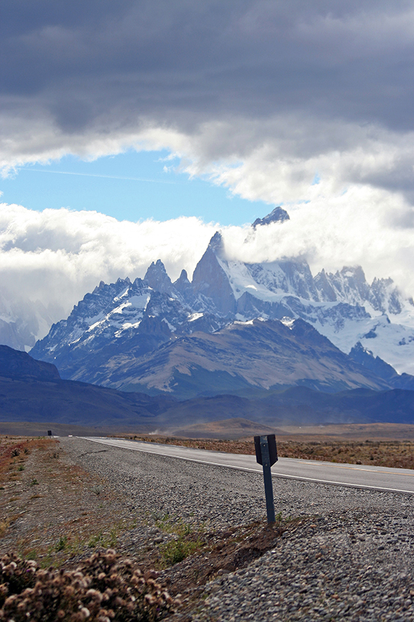 Road sign and peaks in Patagonia
