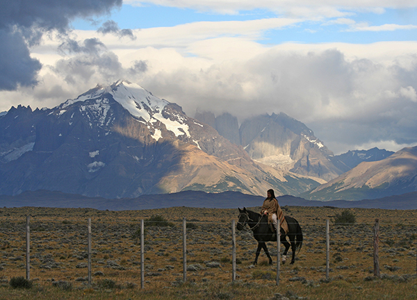 Woman riding horse in Patagonia