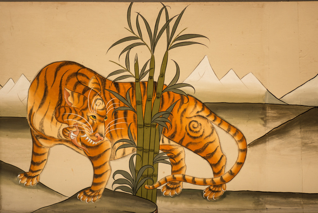 A mural of a tiger on the wall of a monastery entranceway in Bhutan. © Rachel Kramer/WWF-US