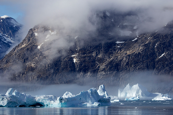 Greenland mountains and icebergs