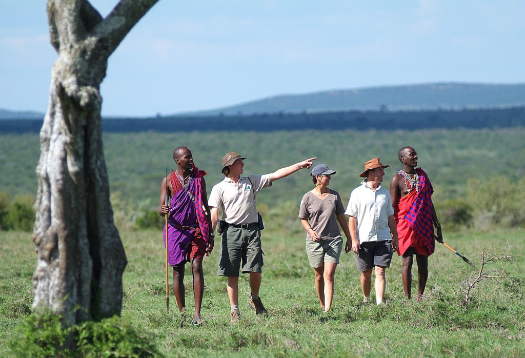Maasai and safari guests at Mara Siana Conservancy, Kenya