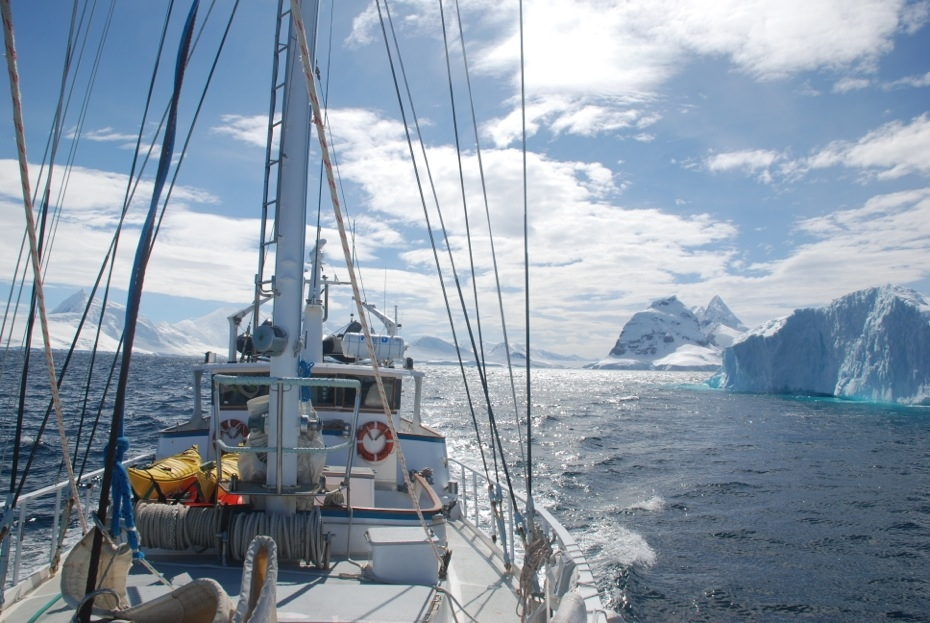 Sailboat with ice in the Lemaire Channel, Antarctica