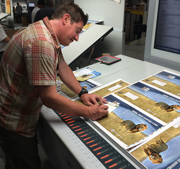 Creative Director Mark Hickey signs off on the 2017 catalog cover. Approved!