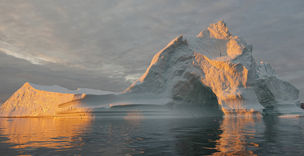 An iceberg floats in Disko Bay, near Ilulissat, Greenland, on July 24, 2015. The massive Greenland ice sheet is shedding about 300 gigatons of ice a year into the ocean, making it the single largest source of sea-level rise from melting ice. ©NASA/Saskia Madlener, flickr
