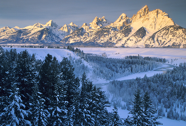 Unencumbered by foothills, the Teton Range has magnificent peaks that stand nearly 7,000 feet above the valley floor. Especially in winter, they provide one of the most impressive and soul-stirring views in the Rockies. ©Henry H. Holdsworth