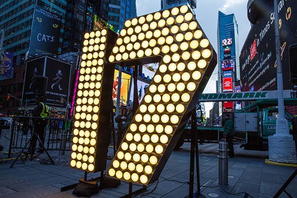 "In preparation for New Year's Eve 2017, the numerals ""one"" and ""seven"" arrive in New York, ready to be hoisted above Times Square by Landmark Signs workers. ©Countdown Entertainment, LLC."