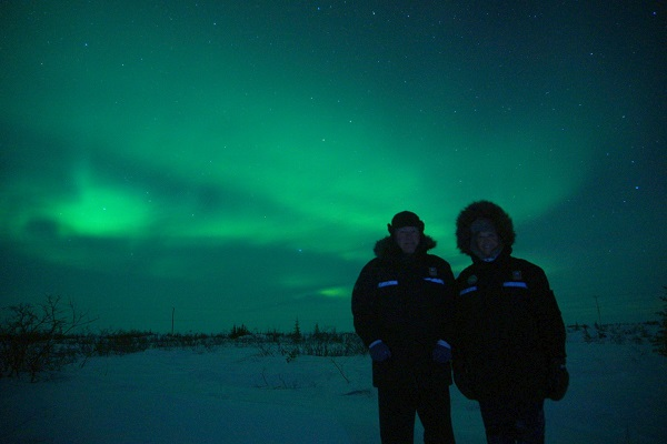 A couple under the northern lights
