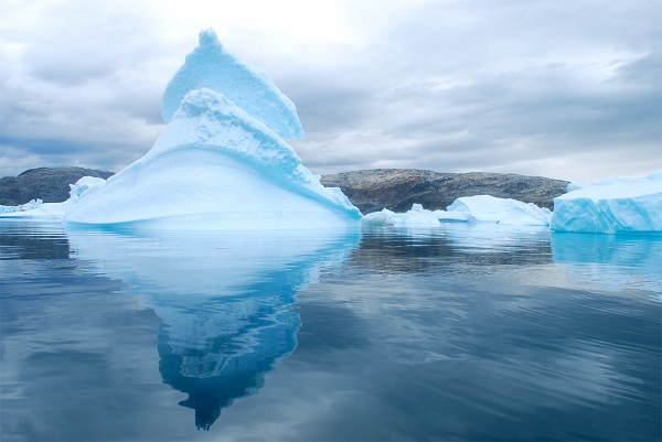 "Cloudy skies in Sermilik Fjord's ""iceberg graveyard"" lend a mysterious quality to the Arctic landscape."