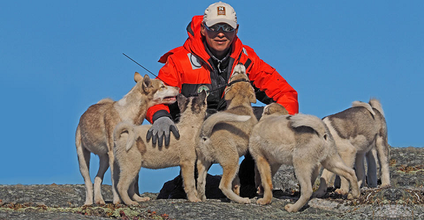 Julius Nielsen with sled dogs in Greenland