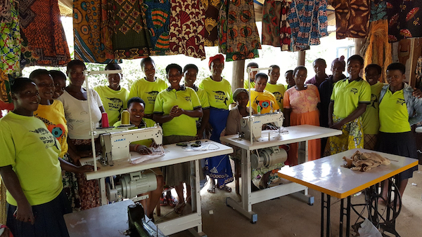 The women of Ride 4 A Woman enjoying their new sewing machines donated by Natural Habitat Adventures.