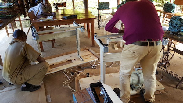 Constructing the two new sewing machines Nat Hab donated to 'Ride 4 A Woman.'